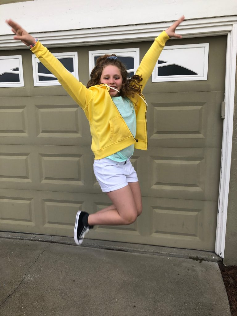 Old Navy pastel top, white denim shorts, and yellow jacket. Converse shoes.