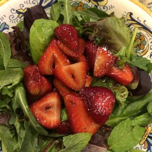 Salad greens with strawberries